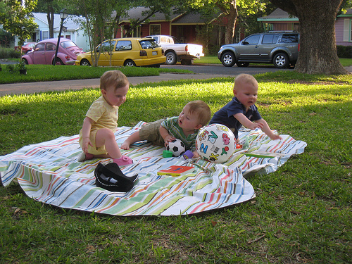 3 babies playing outdoors on blanket, credit: http://www.flickr.com/photos/whiskeytango/2567398133/sizes/m/