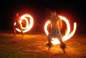 long exposure photograph of Polynesian fire dancers